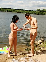 A couple having outdoor naked fun