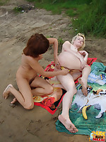 These two sexy chicks like to eat pussy and suck on nipples at a very public nude beach