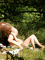 A totally naked couple kicking back and relaxing on a nude beach